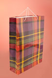 Paper shopping bag. Colourful paper shopping bag isolated on red Stock Image
