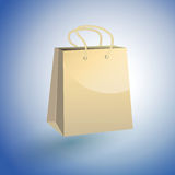 Paper Shopping Bag on blue background Stock Images