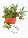 Paper shopping bag with Christmas decorations and notebook isola. Ted on white background Royalty Free Stock Photo