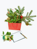 Paper shopping bag with Christmas decorations and notebook isola Royalty Free Stock Photo