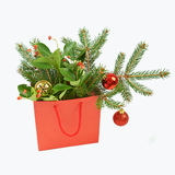 Paper shopping bag with Christmas decorations on white backgroun Royalty Free Stock Photos