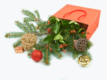 Paper shopping bag with Christmas decorations on white backgroun. D Stock Photography