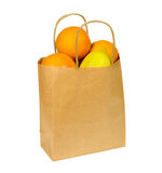 Paper shopping bag full of citrus fruits isolated on white Stock Photography