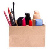 Paper shopping bag full of makeup cosmetics and accessories Royalty Free Stock Photography