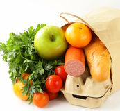 Paper shopping bag full of products (bread, eggs, sausage) Royalty Free Stock Photography