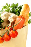 Paper shopping bag full of products (bread, eggs, sausage) Stock Image