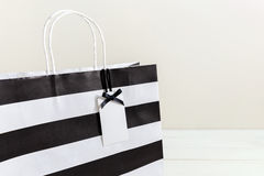 Paper shopping bag with gift tag Royalty Free Stock Photo
