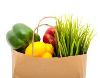 Paper shopping bag with green grass,fruit and Royalty Free Stock Images