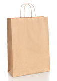 Paper shopping bag with handles over white Royalty Free Stock Image