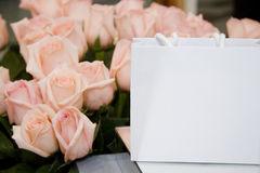 Paper shopping bag. Shopping bag isolated on a rose background Stock Photography