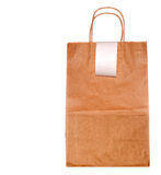 Paper Shopping Bag And Register Tape. Brown paper bag with handles and blank register tape, white iso Stock Image