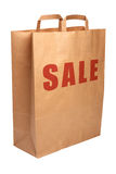 Paper shopping bag for sale. Royalty Free Stock Images