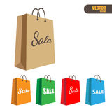 Paper shopping bag with sale promotion. Royalty Free Stock Photos