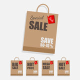 Paper shopping bag with sale promotion. Royalty Free Stock Image