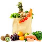 Paper shopping bag with vegetables and fruits, berries Stock Photo
