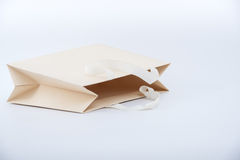 Paper shopping bag on white background Stock Photos