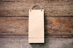 Paper shopping bag on wooden Stock Photos