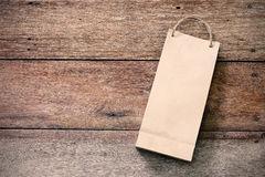 Paper shopping bag on wooden Royalty Free Stock Photos