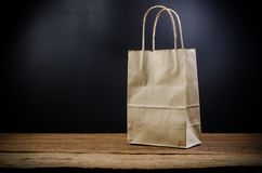 Paper shopping bag. On wooden board Stock Photography