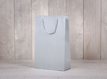 Paper shopping bag on wooden table Royalty Free Stock Photo