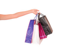 A hand holding paper shopping bags Stock Photos