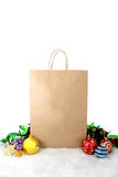 Paper shopping bags christmas decoration with balls and stars on Stock Photo