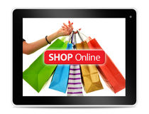 Paper shopping bags on computer tablet screen Stock Images