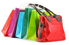Paper shopping bags and handbag on white Stock Image