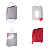 Paper shopping bags and tag isolated on white. Set Royalty Free Stock Photos