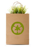 Paper shopping eco bag with green grass. Isolated over white background Stock Photo