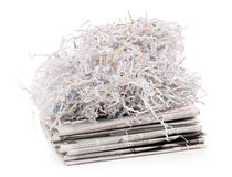 Paper shred on newspaper Stock Images