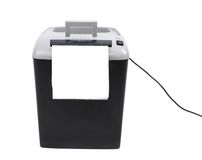 Paper shredder against plain background Royalty Free Stock Photos