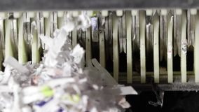 Paper shredder chopping up and tearing documents stock video footage