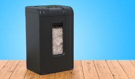 Paper shredder on the wooden table. 3D rendering royalty free illustration