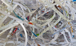 Paper Shredding. Important documents shredded to prevent identity theft Stock Photos