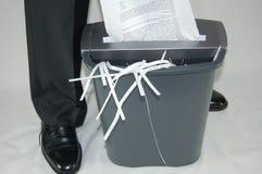 Paper shredding. Business man shredding paper Stock Photo