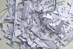 Paper shreddings. Shredding paper with confidential and senzitive private documents Stock Photo