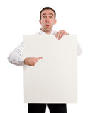 Paper Sign. A young man holding up a paper sign, which you can use for your text, isolated against a white background Royalty Free Stock Photos