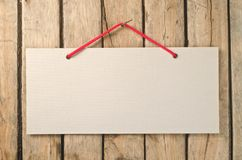 Paper signboard. On the old wooden background royalty free stock image