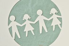 Paper silhouette of children - Ecology and social responsibility. Paper silhouette cut of children chain - Ecology and social responsibility concept royalty free stock image