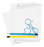 A paper with a sketch of a boy pulling a bag Royalty Free Stock Images