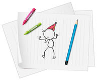 A paper with a sketch of a person with crayons and a pencil Royalty Free Stock Photography