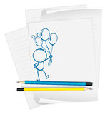 A paper with a sketch of a person holding balloons Royalty Free Stock Image