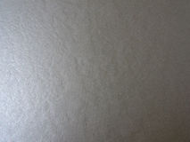 paper skinande silver Arkivbild