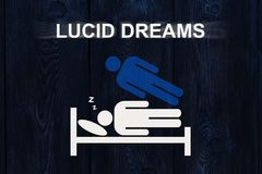 Paper sleeping man on bed with text LUCID DREAMS. Out of body, astral projection experience concept stock image