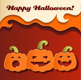 Paper smiling pumpkins Stock Image