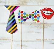 Paper Party Accessories. Paper smiling red mouth,tie,and bow tie .Party accessory stock photos