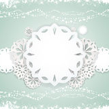 Paper snowflake background on blue Royalty Free Stock Photography