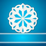 Paper snowflake and banner on blue Royalty Free Stock Image