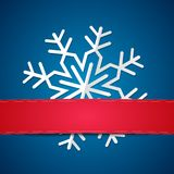 Paper snowflake on colored background Royalty Free Stock Images